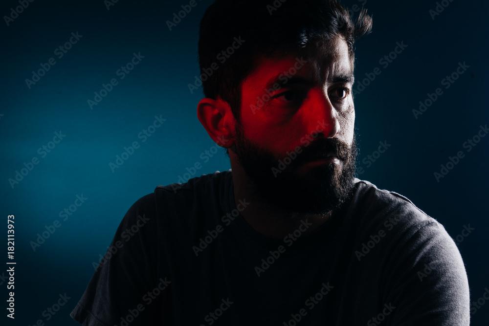 Fototapeta Dramatic portrait of bearded man. Concept of sadness, depression, alert