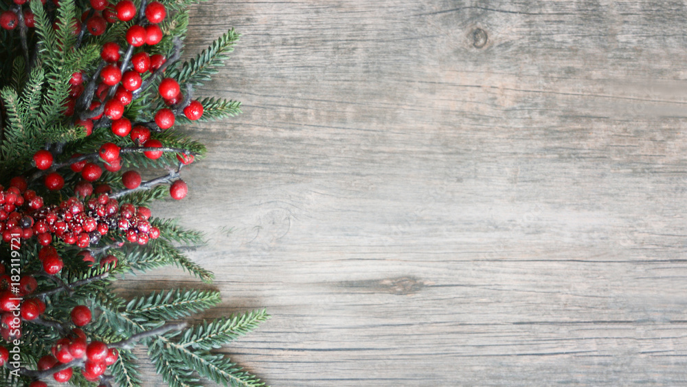 Fototapety, obrazy: Holiday Evergreen Branches and Berries Over Rustic Wood Background
