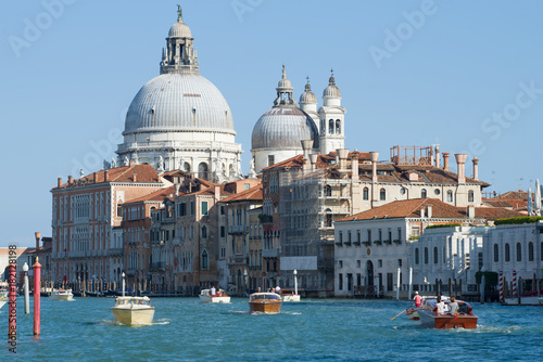 Photo Stands Venice Dome of the Cathedral of Santa Maria della Salute above the Grand Canal. Venice, Italy