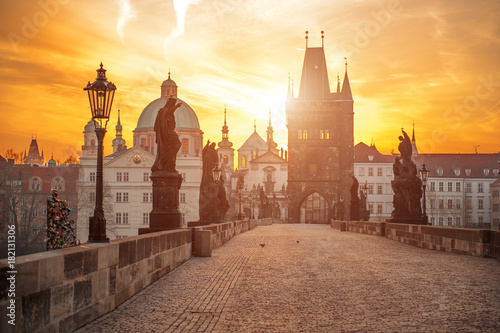 Prague Scenic view of Charles Bridge (Karluv Most) and Lesser Town Tower Prague symbol at sunrise, Czech Republic
