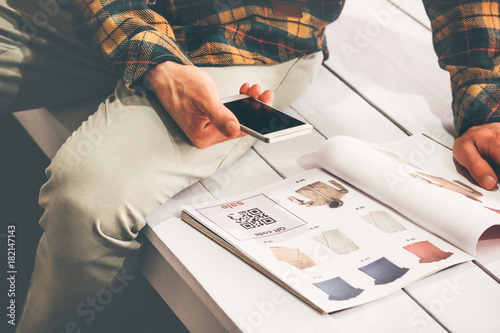 Valokuva  Man shopping scanning qr code advertising with smartphone on clothes catalog mod