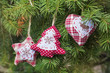 Christmas Decorative Ornaments hanging on Pine Tree Branch