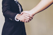 Trust your partner company. Business partnership meeting concept. Successful businessman and Investor or sales manager or Lawyer or Real estate broker agent and customer handshaking after good deal.