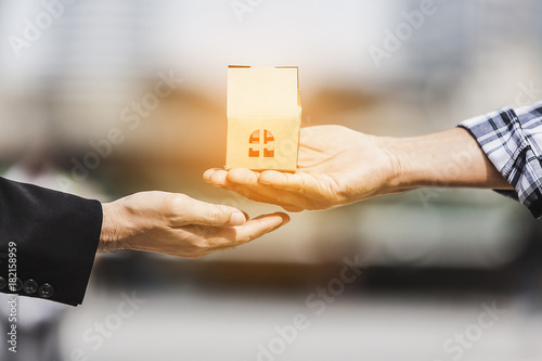 Fotografie, Obraz  Close up of male hand giving gift a new house