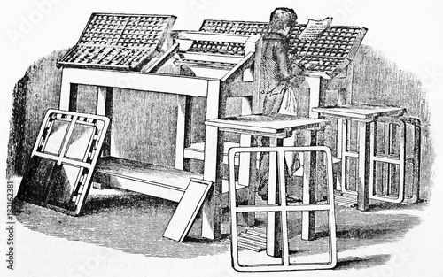 Old illustration of movable type composition in printing workshop Slika na platnu