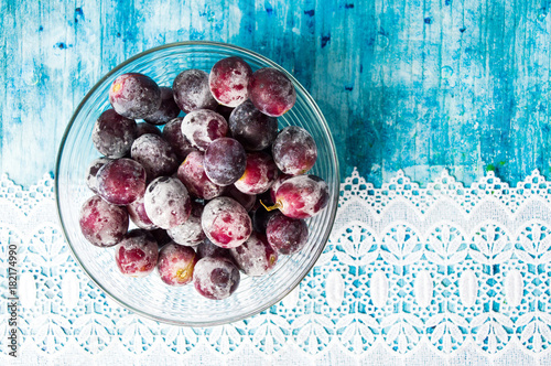 Frozen grapes cluster in the bowl