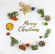 MERRY CHRISTMAS TYPOGRAPHY WITH COMPOSITION IN CIRCLE ON WHITE BACKGROUND. HOLIDAY DECOR ON FLAT LAY