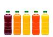 Glass bottles with fresh organic juice on white