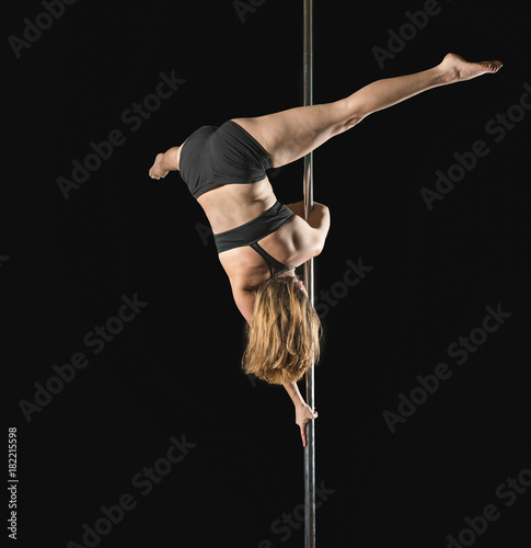 Fotografie, Obraz  Young woman practicing pole fitness positions