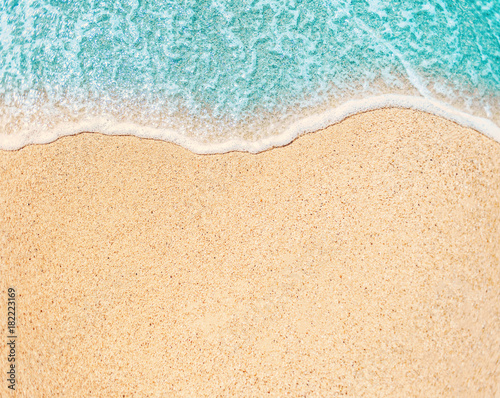 Foto auf Gartenposter Strand Sea Beach and Soft wave of blue ocean. Summer day and sandy beach background. Copy space of summer vacation or business travel concept. .