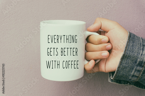 Cuadros en Lienzo Hands Holding a Coffee Mug With Text Quote - Everything Gets Better With Coffee