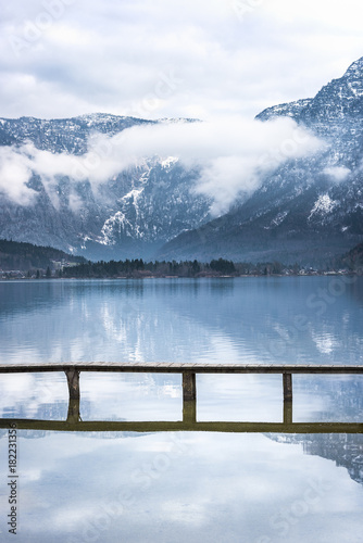 Foto auf Gartenposter Reflexion Alps mountains reflected in water - Travel locations theme image with the Northern Limestone Alps reflected in the Hallstatter lake and a bridge that crosses it, located in Hallstatt, Austria.