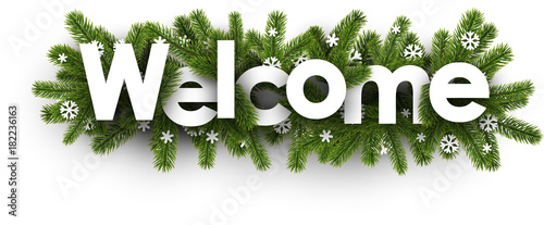Fotografía  Welcome banner with spruce branches.
