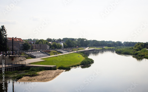 City on the water View on embankment of Warta river in polish town Konin.