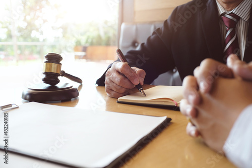 Fotografering Legal counsel presents to the client a signed contract with gavel and legal law