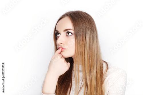 Obraz na plátne Beautiful emotional blonde female model looking pensive wear pajamas