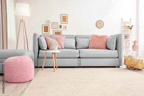Fotografering  Modern living room interior with sofa and carpet