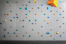 Grey Wall With Climbing Holds ...
