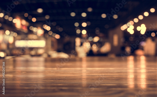 Wood table top with reflect on blur of lighting in night cafe,restaurant background/selective focus. - 182267366