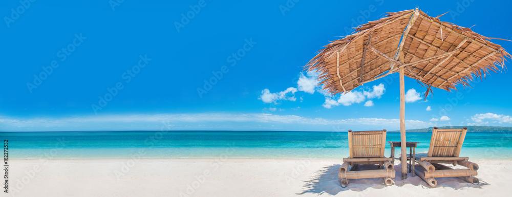 Fototapeta Chaise lounges on beach
