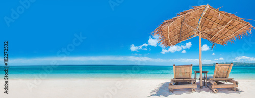 Photo sur Toile Plage Chaise lounges on beach
