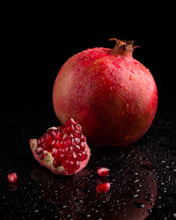 Ripe Pomegranate Fruits On A B...