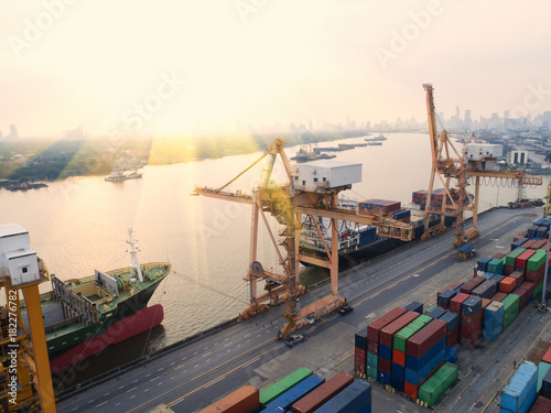City on the water container,container ship in import export and business logistic,By crane,Trade Port , Shipping,cargo to harbor.Aerial view,Water transport,International,Shell Marine,transportation,logistic,trade,port