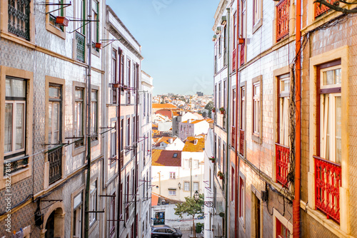 Beautiful street view with beautiful residential buildings in Mouraria district during the morning light in Lisbon city, Portugal