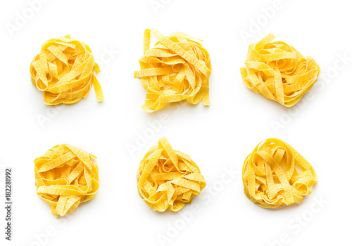 Raw tagliatelle pasta. Fototapeta