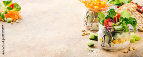 Fotobehang Klaar gerecht Glass jar with lamb's lettuce and vegetables salad. Healthy food, diet, detox, clean eating and vegetarian concept with copy space. Banner.
