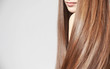 canvas print picture - Beautiful young woman with long straight hair on light background
