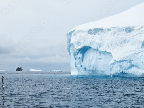 Ice berg and expedition ship