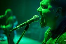 Bearded Singer Sings At A Micr...