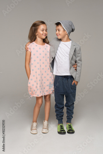 A portrait of a laughing girl and a smiling boy. summer style Wall mural