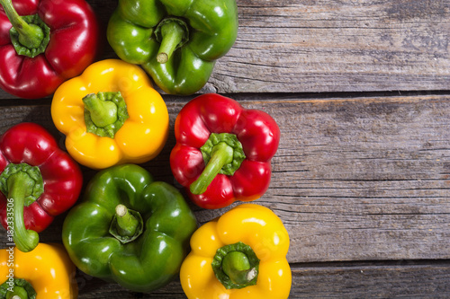 Cuadros en Lienzo Colorful green , red and yellow peppers