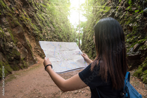 Back side of young traveler see the map in the deep forest, Hellfire Pass at kan Fototapet