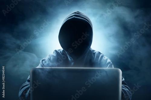 Fotografia  Hacker using laptop