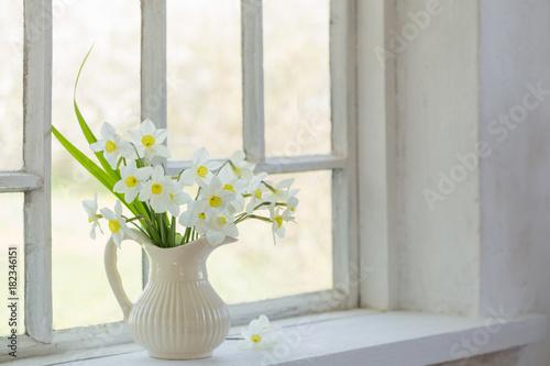 daffodils in jug on windowsill