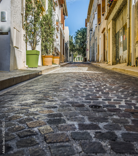 Low angle image of narrow, cobblestone street in Europe Canvas Print