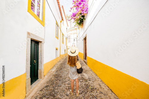 Young woman traveling on the street in the old town of Evora in Portugal Canvas Print