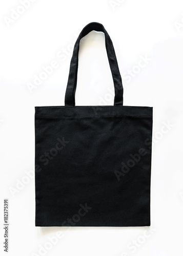 Fototapeta Black canvas tote bag mockup fabric cloth texture for woman's shoulder eco shopping sack mock up template isolated on white background (clipping path) obraz