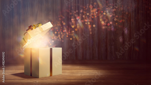 Fotografija  Geschenk leuchtet als Überraschung zu Weihnachten