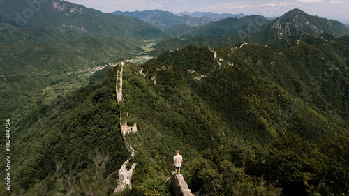 Off the beaten track traveller exploring the great wall of china