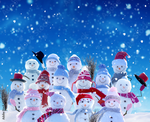 Spoed Foto op Canvas Violet Merry Christmas and happy New Year greeting card with copy-space.Many snowmen standing in winter Christmas landscape.Winter background