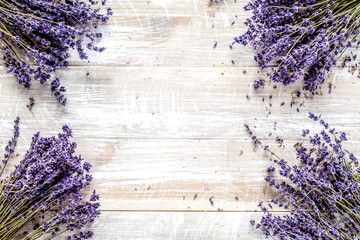 Fototapetadry lavander design with bouquet on wooden background top view m