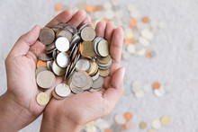 A Lot Of Coins In The Hands. Save Money With Stack Money Coin. Hands Holding Thai Coins.