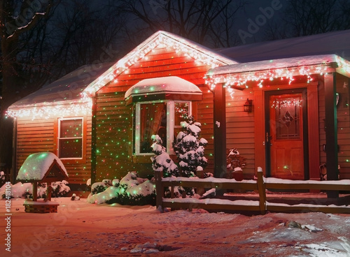 Fairytale House Decorated For Winter Holidays Season Covered By Fresh Snow Glowing In The Dark During