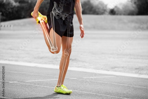 Highlighted bones of athlete man stretching on race track Wallpaper Mural
