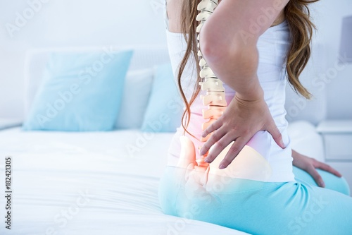 Cuadros en Lienzo Digital composite of highlighted spine of woman with back pain