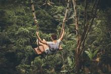 Young Tourist Woman Swinging O...